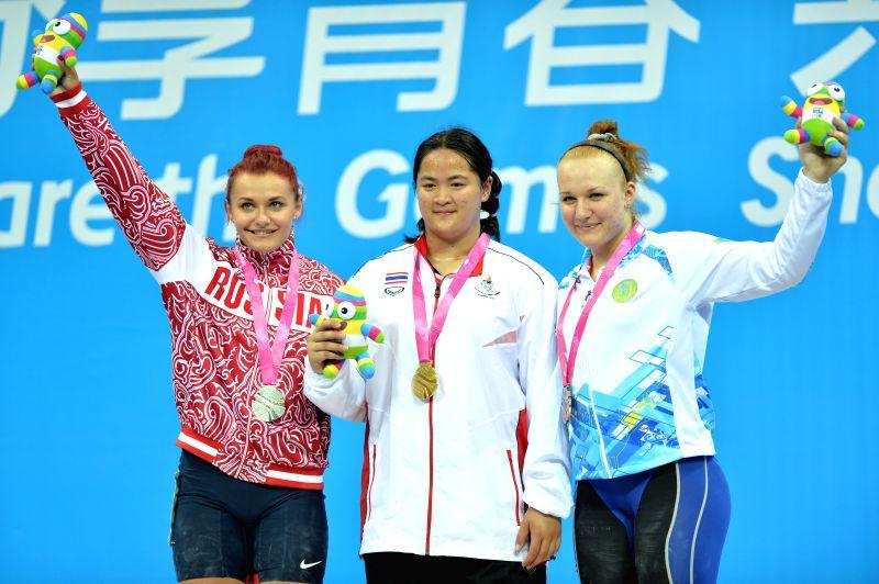 Gold medalist Duanganksorn Chaidee(C) of Thailand, silver medalist Svetlana Shcherbakova(L) of Russian Federation and bronze medalist Tatyana Kapustina of ...