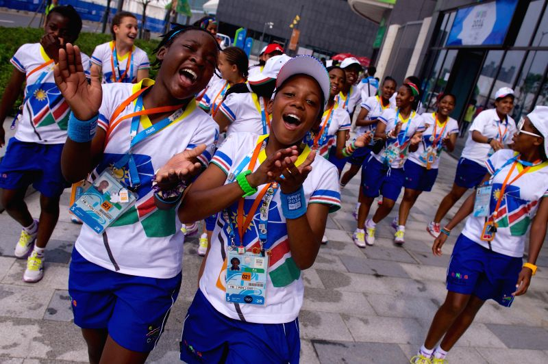 Girls from Namibia sing and dance in the athletes village of Nanjing 2014 Youth Olympic Games in Nanjing, capital of east China`s Jiangsu Province, on Aug. 22, ...