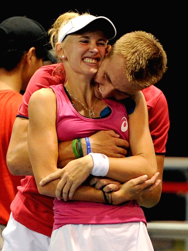 Jil Teichmann (L) of Switzerland and Jan Stanislaw Zielinski of Poland celebrate victory after the mixed doubles final against Ye Qiuyu of China and Jumpei Yamasaki