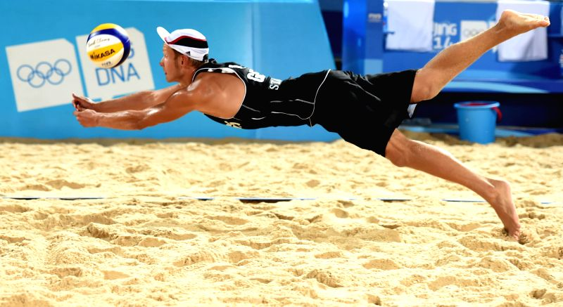 Eric Stadie of Germany saves the ball during the men's quarterfinal match of beach volleyball event against Argentina at the Nanjing 2014 Youth Olympic Games in ...