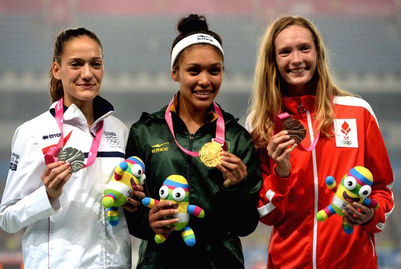 Gold medalist Gezelle Magerman of South Africa, silver medalist Michaela Peskova of Slovakia and bronze medalist Anne Sofie Fruerskov Kirkegaard of Denmark pose for