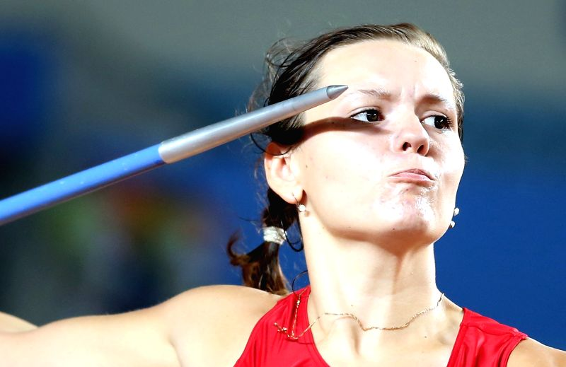 Gold medalist Hanna Tarasiuk of Belarus competes in the Women's Javelin Throw of athletics event of Nanjing 2014 Youth Olympic Games in Nanjing, capital of east ...