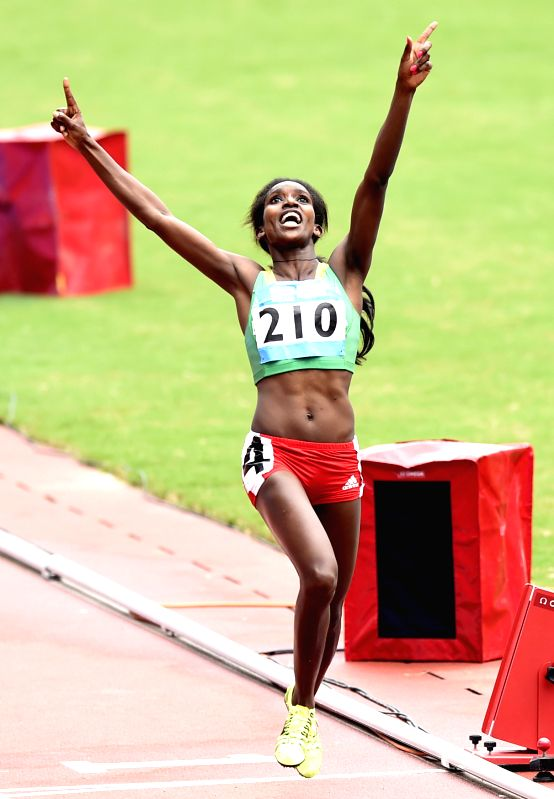 Gold Medalist Kokeb Tesfaye Alemu of Ethiopia celebrates after crossing the finish line in the Women?s 1500m Final of athletics event at the Nanjing 2014 Youth ...
