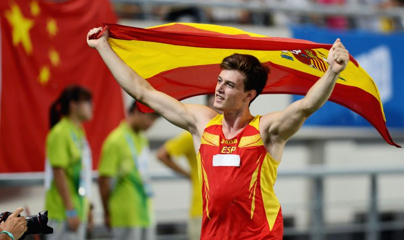 Gold medalist Noel-Aman Del Cerro Vilalta of Spain celebrates victory after men's pole vault at the Nanjing 2014 Youth Olympic Games in Nanjing, east China's ...