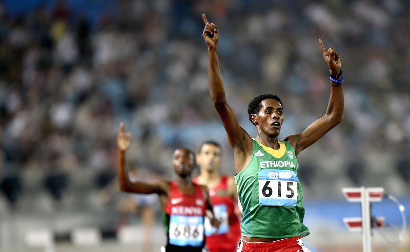 Gold medalist Wogene Sebisibe Sidamo (R) of Ethiopia celebrates victory after men's 2000m steeplechase  at the Nanjing 2014 Youth Olympic Games in Nanjing, east ...