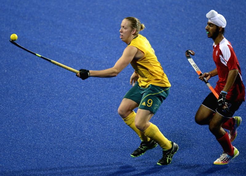 Corey Weyer (L) of Australia competes during the men's hockey5s gold medal match at Nanjing 2014 Youth Olympic Games in Nanjing, capital of east China's Jiangsu ...