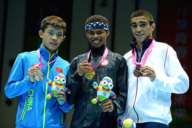 Gold medalist Shakur Stevenson of the United States of America, silver medalist Lv Ping of Republic of China and bronze medalist Muhammad Ali of India pose for ...