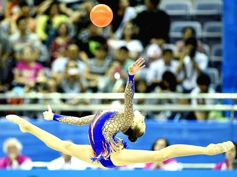 Maryia Trubach of Belarus competes during the Individual All-Around Final of Rhythmic Gymnastics at the Nanjing 2014 Youth Olympic Games in Nanjing, capital of east