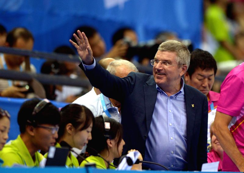 Thomas Bach, the president of International Olympic Committee, greets to the audience at the Nanjing OSC Gymnasium of the Nanjing 2014 Youth Olympic Games in ...
