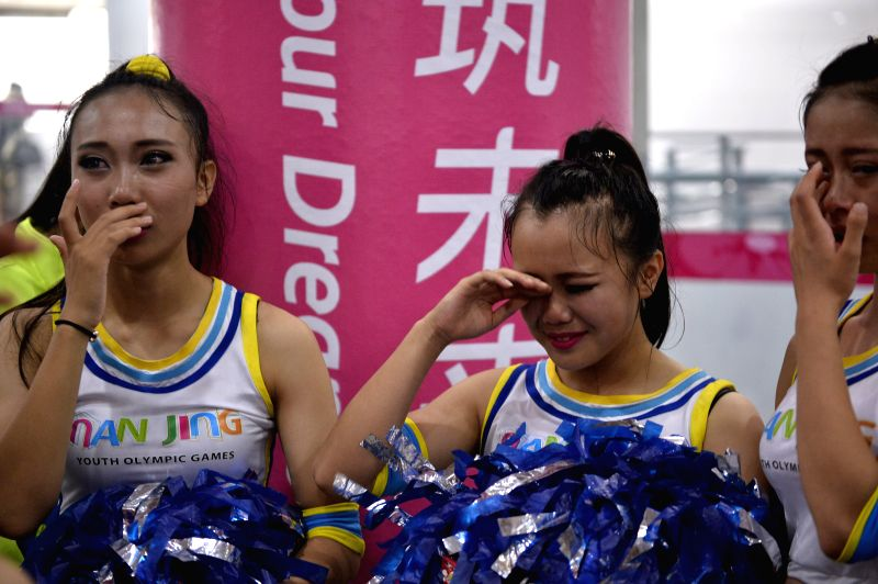 Artists burst into tears after the closing ceremony of Nanjing 2014 Youth Olympic Games in Nanjing, capital of east China?s Jiangsu Province, Aug. 28, 2014. ...