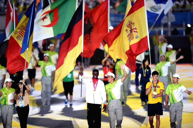 Delegation flags enter the stadium during the closing ceremony of Nanjing 2014 Youth Olympic Games in Nanjing, capital of east China`s Jiangsu Province, Aug. 28, ...