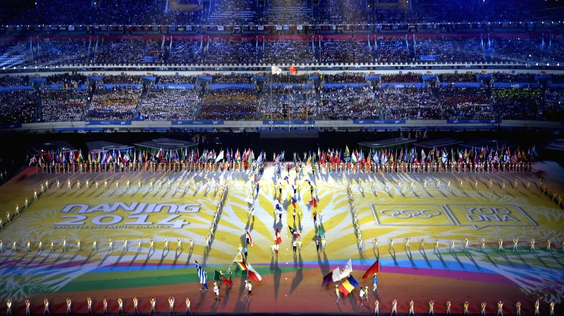 Flags of national delegations enter the stadium during the closing ceremony of Nanjing 2014 Youth Olympic Games in Nanjing, capital of east China`s Jiangsu ...