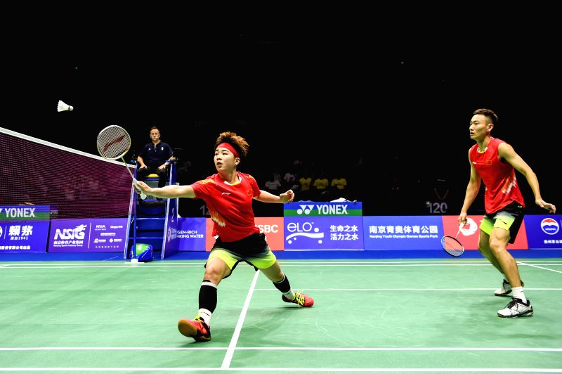 NANJING, Aug. 3, 2018 - Zhang Nan (R)/Li Yinhui of China compete during the mixed doubles quarterfinal match against Mathias Christiansen/Christinna Pedersen of Denmark at the BWF (Badminton World ...