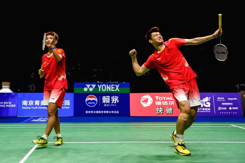 NANJING, Aug. 4, 2018 - Wang Yilyu (R)/Huang Dongping of China celebrate victory after the mixed doubles semifinal match against Tang Chun Man/Tse Ying Suet from Hong Kong of China at the BWF ...