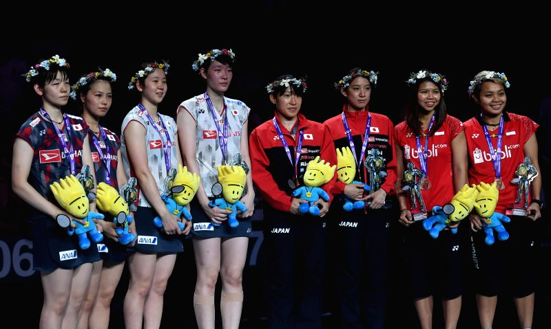 NANJING, Aug. 5, 2018 - Gold medalists Mayu Matsumoto (4th L) and Wakana Nagahara (3rd L) of Japan pose on the podium after winning the women's doubles final match with silver medalists Sayaka Hirota ...