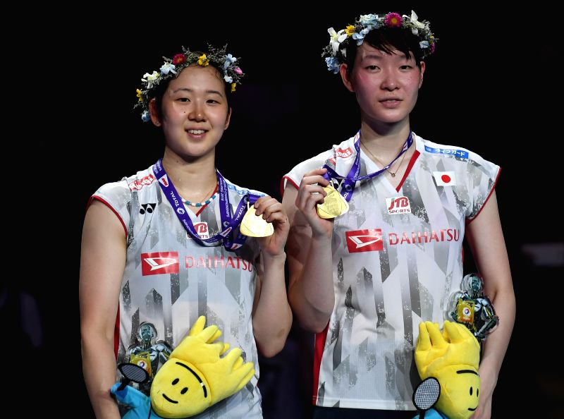 NANJING, Aug. 5, 2018 - Mayu Matsumoto (R) and Wakana Nagahara of Japan pose on the podium after winning the women's doubles final match against Yuki Fukushima and Sayaka Hirota of Japan at the BWF ...