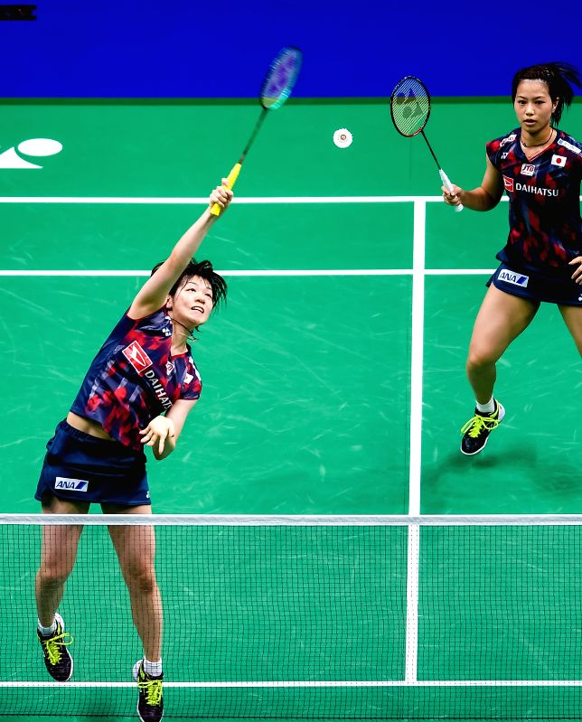 NANJING, Aug. 5, 2018 - Yuki Fukushima and Sayaka Hirota (L) of Japan compete during the women's doubles final match against Mayu Matsumoto Wakana Nagahara of Japan at the BWF (Badminton World ...
