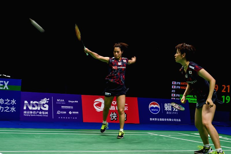 NANJING, Aug. 5, 2018 - Yuki Fukushima (L) and Sayaka Hirota of Japan compete during the women's doubles final match against Mayu Matsumoto and Wakana Nagahara of Japan at the BWF (Badminton World ...