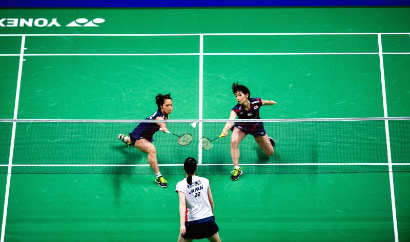 NANJING, Aug. 5, 2018 - Yuki Fukushima (L) and Sayaka Hirota (R) of Japan compete during the women's doubles final match against Mayu Matsumoto (C) and Wakana Nagahara of Japan at the BWF (Badminton ...