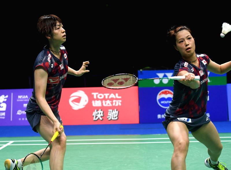 NANJING, Aug. 5, 2018 - Yuki Fukushima (R) and Sayaka Hirota of Japan compete during the women's doubles final match against Mayu Matsumoto and Wakana Nagahara of Japan at the BWF (Badminton World ...