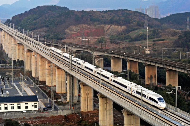 Nanjing (China): A train runs on the Shanghai-Kunming high-speed railway during a trial operation in Yiwu, east China's Zhejiang Province, Dec. 4, 2014. The Hangzhou-Nanchang high-speed railway ...