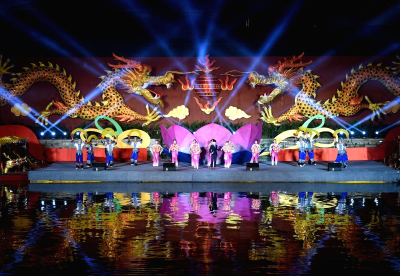 A performance is staged at the illumination ceremony of the Qinhuai Lantern Fair beside the Qinhuaihe River in Nanjing, capital of east China's Jiangsu Province, ...