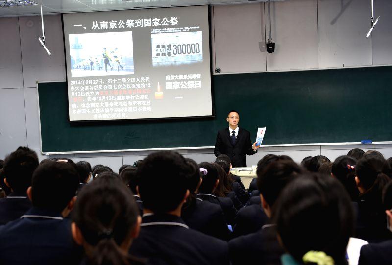 History instructor Fan Shiwen teaches in a course opened in Nanjing No. 1 Middle School in Nanjing, capital of east China's Jiangsu Province, Dec. 2, 2014. Nanjing opened courses Tuesday for