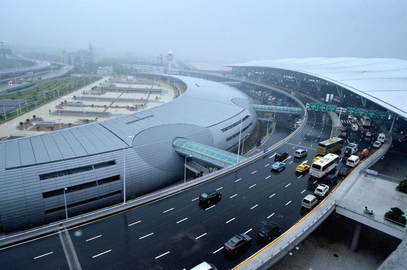 Photo taken on July 12, 2014 shows the newly-built Terminal 2 of Lukou Airport in Nanjing, capital of east China's Jiangsu Province. The T2 of Nanjing's Lukou ...