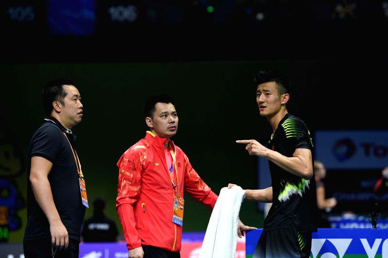 NANJING, July 30, 2018 - Chen Long (R) of China receives instructions from his coach during the first round match against Hsu Jen Hao of Chinese Taipei at the 2018 BWF World Championships in Nanjing, ...