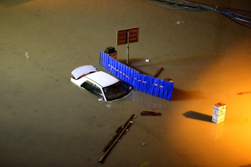 NANNING, June 4, 2016 - A car is almost submerged in water on Jianzheng East Road in Nanning, capital of south China's Guangxi Zhuang Autonomous Region, June 4, 2016. Some areas of Nanning were ...
