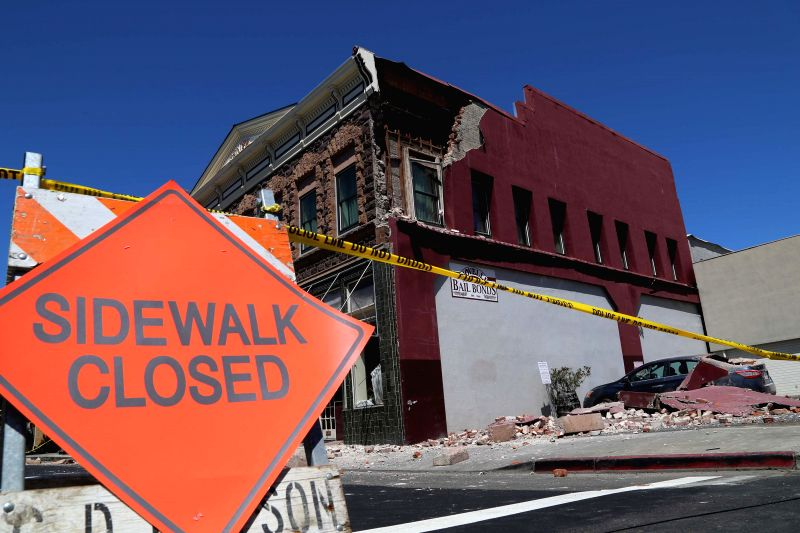 NAPA (U.S.), Aug. 25, 2014 A warning line is seen in front of a building damaged in an earthquake in Napa, the U.S., Aug. 24, 2014. An earthquake with preliminary magnitude of 6.0 that ...
