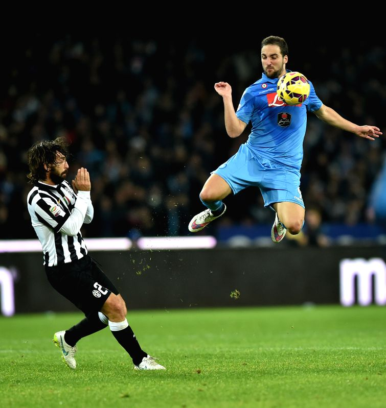 Juventus' Andrea Pirlo (L) vies with Napoli's Gonzalo Higuain during their Italian Serie A soccer match at the San Paolo stadium in Naples, Italy, Jan. 11, 2015. ...