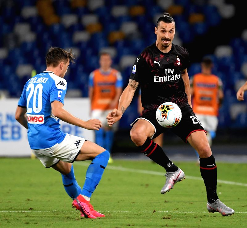 NAPLES, July 13, 2020 (Xinhua) -- AC Milan's Zlatan Ibrahimovic (R) vies with Napoli's Piotr Zielinski during a Serie A football match between Napoli and AC Milan in Naples, Italy, July 12, 2020. (Photo by Alberto Lingria/Xinhua/IANS)