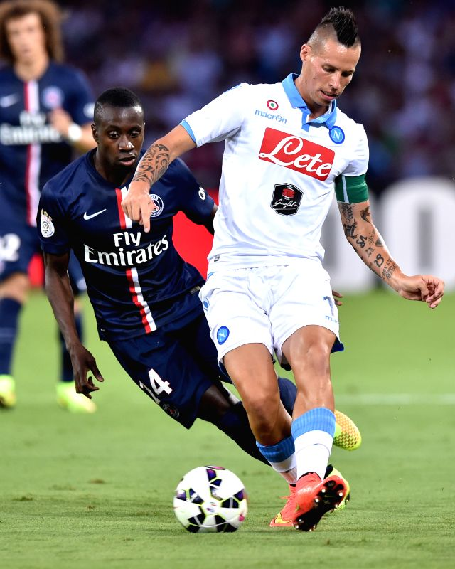 Paris Saint-Germain's Blaise Matuidi (L) vies with Napoli's Marek Hamsik during a friendly football match in Napoli, Italy, Aug.11, 2014. Saint-Germain won ...