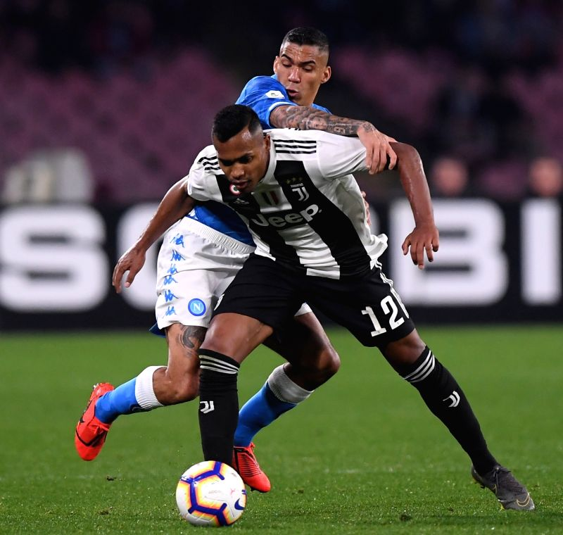 NAPOLI, March 4, 2019 (Xinhua) -- Juventus's Alex Sandro (front) vies with Napoli's Allan during a Serie A soccer match between Napoli and Juventus in Napoli, Italy, March 3, 2019. Juventus won 2-1. (Xinhua/Alberto Lingria/IANS)