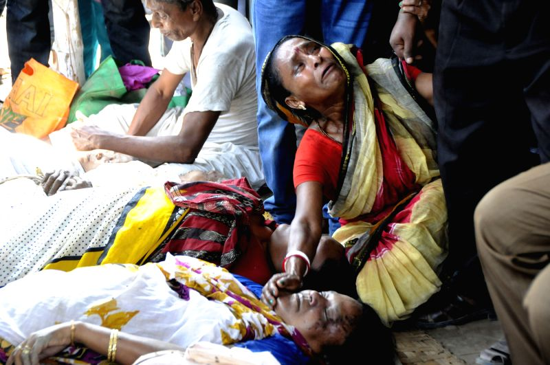 A women mourns as she found her relative's dead body after a stampede during a Hindu holy bathing festival on the outskirts of Dhaka, Bangladesh, March 27, ...
