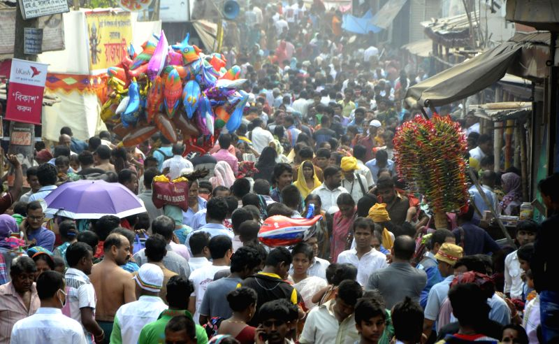Hindu devotees gather during a Hindu holy bathing festival in Narayanganj on the outskirts of Dhaka, Bangladesh, on March 27, 2015. At least 10 people were ...