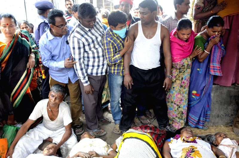 People search for bodies after ten people died in a stampede during a Hindu holy bathing festival on the outskirts of Dhaka, Bangladesh, March 27, 2015. At ...