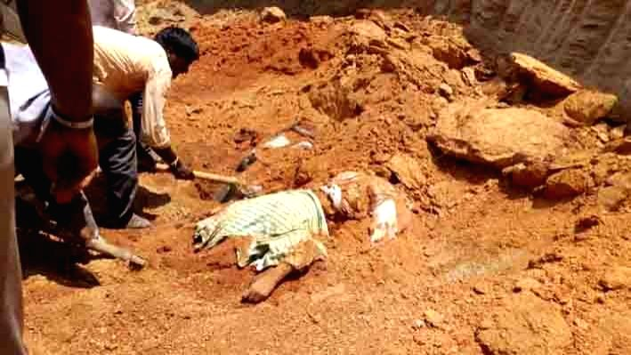 Narayanpet: A body of a labour found, who was killed along with 9 other labourers after a mound of clay fell on them during digging works in Telangana's Narayanpet district, on April 10, 2019. (Photo: IANS)