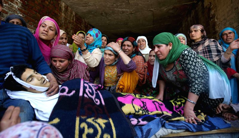 Relatives of teenage student Suhail Ahmad Bhat mourn over his body at Narbal in Jammu and Kashmir, on April 18, 2015. The teenager was shot by security forces during protest against the ...