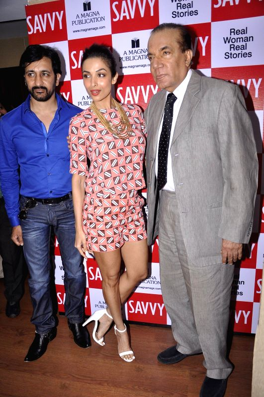 Nari Hira, CMD, Meghna Publishing Company, television actor Rajeev Paul and actor Malaika Arora Khan during the unveiling of latest cover of Savvy magazine in Mumbai on July 7, 2014. - Rajeev Paul