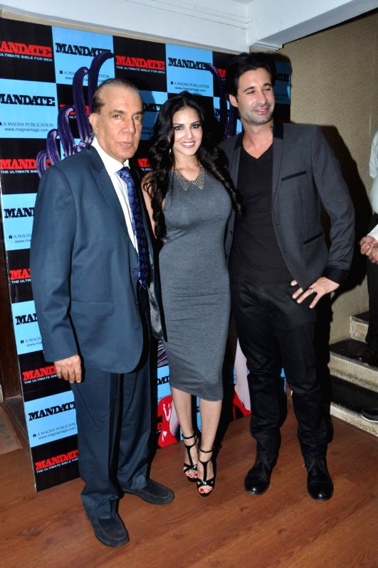 Nari Hira, CMD, Meghna Publishing Company and Bollywood actor Sunny Leone along with her husband Daniel Weber during the launch of men`s magazine Mandate April issue, in Mumbai, on April 10, 2014.