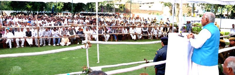 Haryana Chief Minister Manohar Lal Khattar addresses a public meeting in Narnaul, Haryana on Nov 24, 2014. - Manohar Lal Khattar