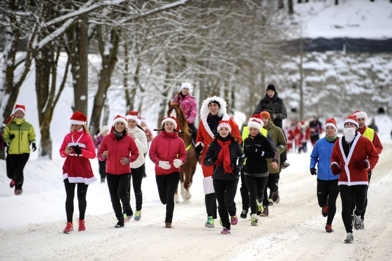 The Estonian run lovers run with Christmas costumes around the city of Narva, Estonia, on Dec. 27, 2014. The Estonian run lovers held a charity Christmas Run in ...