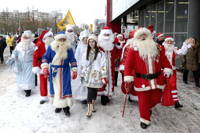 Christmas characters march along the street during the International SantaFest 2016 in Narva, eastern Estonia.