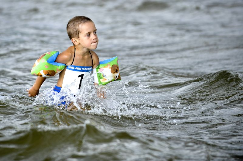 NARVA-A boy participates in the Sea Mile Cross, a kind of summer beach game, at the beach of Narva-Joesuu, Estonia, on Aug. 1, 2014.