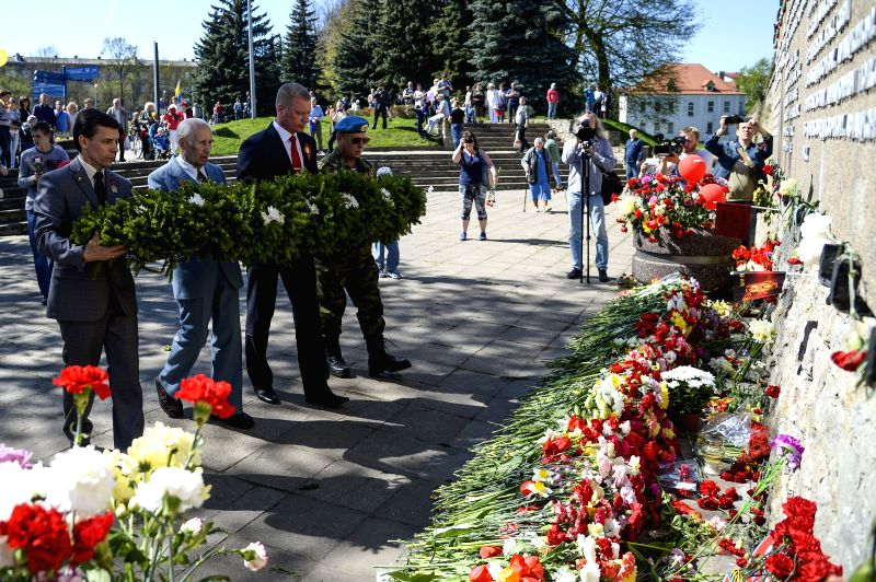 NARVA, May 10, 2016 - People attend a wreath laying ceremony at the monument of the WWII victims during the commemoration of the 71st anniversary of the victory in World War II, in Narva, Estonia, ...
