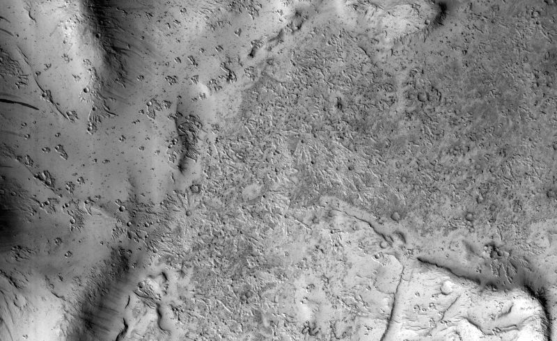 NASA\'s Mars Reconnaissance Orbiter (MRO) captured this region of Mars, sprayed with secondary craters from 10-kilometre Zunil Crater to the northwest. Photo: NASA