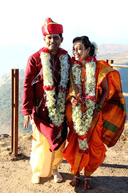 Vikvek Patil, an engineer and Swapnali Dhabugade, a cost accountant tie knots atop the misty Mt. Kalsubai, Maharashtra`s tallest peak at 1646 metres in the presence of families of both sides . - Vikvek Patil