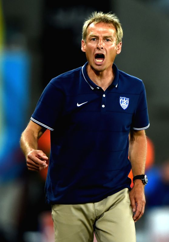 Coach of U.S. Jurgen Klinsmann gives instructions during a Group G match between Ghana and U.S. of 2014 FIFA World Cup at the Estadio das Dunas Stadium in Natal, ...